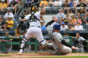 Anthony Rizzo #44 of the Chicago Cubs is forced out at home plate as he slides into the feet of Elias Diaz #32 of the Pittsburgh Pirates in the eighth inning during the game at PNC Park on May 28, 2018 in Pittsburgh, Pennsylvania. MLB players across the league are wearing special uniforms to commemorate Memorial Day.