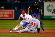 Paul DeJong #12 of the St. Louis Cardinals tags Anthony Rizzo #44 of the Chicago Cubs out at second base in the fifth inning at Busch Stadium on July 27, 2018 in St. Louis, Missouri.