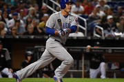 Anthony Rizzo #44 of the Chicago Cubs hits a 3 rbi double in the fifth inning during the game against the  at Marlins Park on March 31, 2018 in Miami, Florida.