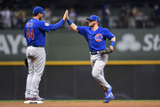 Anthony Rizzo #44 and Ian Happ #8 of the Chicago Cubs celebrate a victory over the Milwaukee Brewers at Miller Park on September 5, 2018 in Milwaukee, Wisconsin.