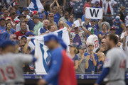 Chicago Cubs fans celebrate the win over the Philadelphia Phillies as assistant hitting coach Andy Haines #19 and Anthony Rizzo #44 walk off the field at Citizens Bank Park on September 2, 2018 in Philadelphia, Pennsylvania.