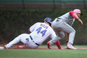 Anthony Rizzo #44 of the Chicago Cubs steals second base ahead of the tage by Yolmer Sanchez #5 of the Chicago White Sox in the 1st inning at Wrigley Field on May 13, 2018 in Chicago, Illinois.