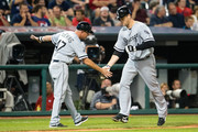 Third base coach Joe McEwing #47 celebrates with Justin Morneau #44 of the Chicago White Sox as he round the bases after hitting a solo home run during the sixth inning against the Cleveland Indians at Progressive Field on August 16, 2016 in Cleveland, Ohio.