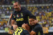 Federico Bernardeschi #33 of Juventus celebrates his goal with his team-mates Emre Can (R) and Giorgio Chiellini (up) during the serie A match between Chievo Verona and Juventus at Stadio Marc'Antonio Bentegodi on August 18, 2018 in Verona, Italy.