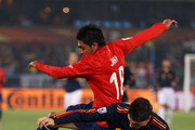 Fernando Torres of Spain is challenged by Gonzalo Jara of Chile during the 2010 FIFA World Cup South Africa Group H match between Chile and Spain at Loftus Versfeld Stadium on June 25, 2010 in Tshwane/Pretoria, South Africa.