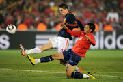 Gonzalo Jara of Chile challenges Fernando Torres of Spain during the 2010 FIFA World Cup South Africa Group H match between Chile and Spain at Loftus Versfeld Stadium on June 25, 2010 in Tshwane/Pretoria, South Africa.