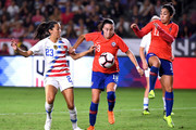 Christen Press #23 of United States looks for the ball in front of Camila Saez #18 and Yesenia Lopez #11 of Chile during the first half at StubHub Center on August 31, 2018 in Carson, California.