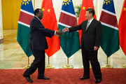 Namibia's President Hage Geingob (L) shake hands with China's President Xi Jinping (R) before their bilateral meeting at the Great Hall of the People on September 2, 2018 in Beijing, China. al-Bashir is in China for the Forum on China-Africa Cooperation which will be held September 3-4 in Beijing.