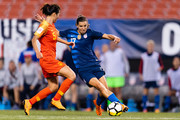 Wu Haiyan #5 of China tries to stop Tobin Heath #17 of the United States during the second half at FirstEnergy Stadium on June 12, 2018 in Cleveland, Ohio. USA defeated China 2-1.