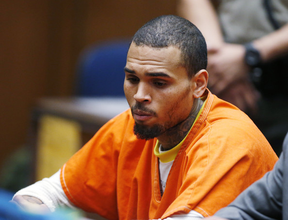 R&B singer Chris Brown appears in court for a probation violation hearing during in Los Angeles Superior on March 17, 2014 in Los Angeles, California. The singer was arrested March 14, 2014 and is being held without bail. Brown was first placed on probation after the 2009 domestic violence case in which he plead guilty to assaulting his then-girlfriend, singer Rihanna.
