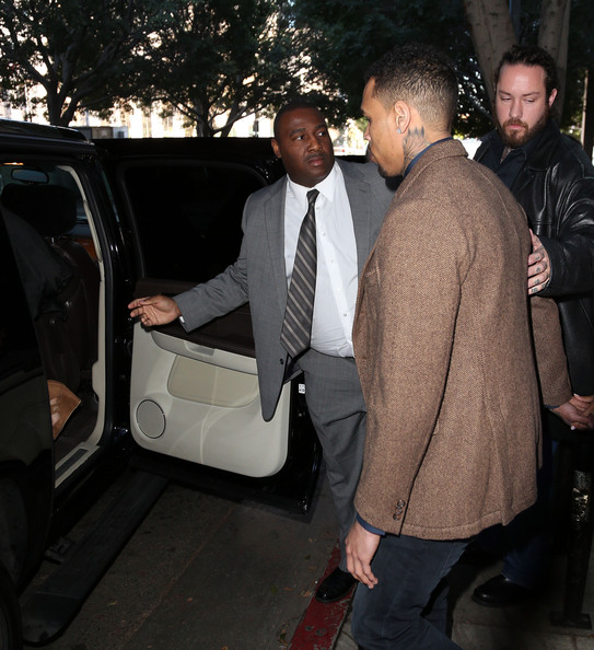 Chris Brown Recording artist Chris Brown leaves the Los Angeles Courthouse on February 3, 2014 in Los Angeles, California.  Brown has been on probation since pleading guilty to assaulting his then girlfriend, singer Rihanna, after a pre-Grammy Awards party in 2009. He has been in anger management treatment program and performing community service requirements but failure to meet probation requirements could be even further complicated by assault charges he and bodyguard Christopher Hollosy face stemming from an incident outside the W hotel in Washington D.C. last October.