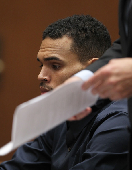 Chris Brown R&B singer Chris Brown appears in court as his attorney Mark Geragos holds papers during a probation progress hearing on February 3, 2014 in Los Angeles, California. Brown has been on probation since pleading guilty to assaulting his then girlfriend, singer Rihanna, after a pre-Grammy Awards party in 2009. He has been in anger management treatment program and performing community service requirements but failure to meet probation requirements could be even further complicated by assault charges he and bodyguard Christopher Hollosy face stemming from an incident outside the W hotel in Washington D.C. last October.