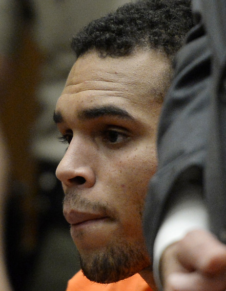 Chris Brown R&B singer Chris Brown appears in court for a probation violation hearing in Los Angeles Superior Court on May 1, 2014 in Los Angeles, California. Brown has been ordered to remain jailed without bail until another court hearing set for May 9.  Brown has been on probation since pleading guilty to assaulting his then girlfriend, singer Rihanna, after a pre-Grammy Awards party in 2009. He has been in anger management treatment program and performing community service requirements. Brown and his bodyguard Christopher Hollosy are also facing misdemeanor simple assault charges after from an incident outside the W hotel in Washington D.C. last October.