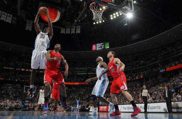 Los Angeles Clippers v Denver Nuggets [photograph,basketball,sports,basketball moves,sport venue,basketball player,basketball court,ball game,player,team sport,kenneth faried,user,chris paul,action,denver,denver nuggets,los angeles clippers,al harrington 7,rebound]