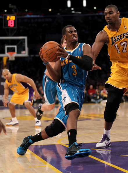 Chris Paul Chris Paul #3 of the New Orleans Hornets drives against Andrew Bynum #17 of the Los Angeles Lakers at Staples Center on January 7, 2011 in Los Angeles, California.  NOTE TO USER: User expressly acknowledges and agrees that, by downloading and or using this photograph, User is consenting to the terms and conditions of the Getty Images License Agreement.