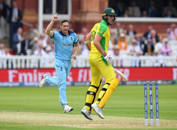 England v Australia - ICC Cricket World Cup 2019 [sports,cricketer,limited overs cricket,sports equipment,cricket,team sport,ball game,player,one day international,first-class cricket,chris woakes,pat cummins,group stage,australia,london,england,lords,australia - icc cricket world cup,match]