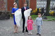 Crown Princess Mary of Denmark and Crown Prince Frederik of Denmark with Princess Isabella of Denmark and Prince Christian of Denmark pose after the christening of their twins Prince Vincent and Princess Josephine at Holmens Kirke on April 14, 2011 in Copenhagen, Denmark.