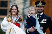 Prince Gabriel of Sweden, Duke of Dalarna held by Princess Sofia of Sweden and Prince Carl Philip holding Prince Alexander, Duke of Sodermanland is the second child of  and attends the christening of Prince Gabriel of Sweden at Drottningholm Palace Chapel on December 1, 2017 in Stockholm, Sweden.