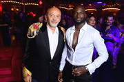 Christian Louboutin and Loic Mabenza attend the Loubicircus Party by Christian Louboutin at Musee des Arts Forains as part of Paris Fashion Week on June 19, 2019 in Paris, France.