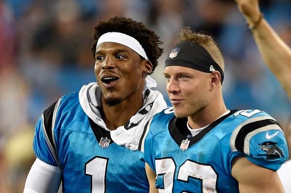 Miami Dolphins v Carolina Panthers [player,facial expression,team sport,ball game,sports,football player,championship,team,tournament,sports equipment,christian mccaffrey,cam newton 1,north carolina,charlotte,bank of america stadium,carolina panthers,miami dolphins,touchdown,game]