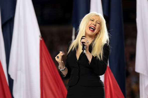 Christina Aguilera Singer Christina Aguilera sings the National Anthem during Super Bowl XLV at Cowboys Stadium on February 6, 2011 in Arlington, Texas.