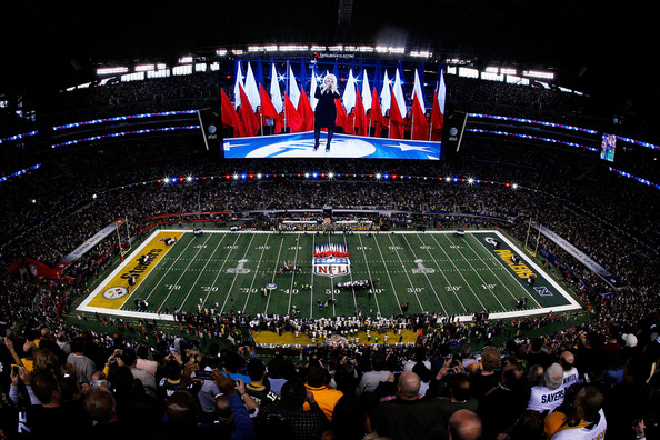 Christina Aguilera Singer Christina Aguilera performs the national anthem during Super Bowl XLV at Cowboys Stadium on February 6, 2011 in Arlington, Texas.