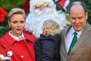 (L-R) Princess Charlene Of Monaco, Prince Jacques of Monaco and Prince Albert II of Monaco attend the annual Christmas gifts distribution at Monaco Palace on December 14, 2016 in Monaco, Monaco.