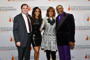 """(L-R) Richard Kind, Michelle Williams, Gayle King, and Keith David arrive at The Christopher & Dana Reeve Foundation """"Magical Evening"""" Gala on November 15, 2018 in New York City."""