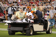 Wide receiver James Wright #86 of the Cincinnati Bengals is carted off the field after an injury during the fourth quarter of the preseason NFL game against the Arizona Cardinals at the University of Phoenix Stadium on August 24, 2014 in Glendale, Arizona.