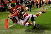 James Wright #86 of the Cincinnati Bengals scores a touchdown against  Phillip Gaines #23 of the Kansas City Chiefs during the fourth quarter at Arrowhead Stadium on August 7, 2014 in Kansas City, Missouri.