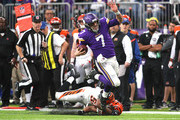 Case Keenum #7 of the Minnesota Vikings is tackled with the ball by Jordan Evans #50 of the Cincinnati Bengals in the first quarter of the game on December 17, 2017 at U.S. Bank Stadium in Minneapolis, Minnesota.