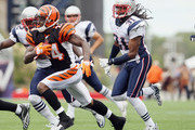 Adam Jones #24 of the Cincinnati Bengals tries to avoid Kyle Arrington #27 and Brandon Meriweather #31 of the New England Patriots during the NFL season opener on September 12, 2010 at Gillette Stadium in Foxboro, Massachusetts.