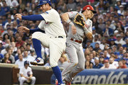 Anthony Rizzo (L) of the Chicago Cubs collides with Derek Dietrich #22 of the Cincinnati Reds during the fourth inning at Wrigley Field on July 16, 2019 in Chicago, Illinois.