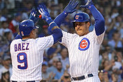 Anthony Rizzo #44 of the Chicago Cubs (R) celebrates his two run home run with Javier Baez #9 in the 1st inning against the Cincinnati Reds at Wrigley Field on August 23, 2018 in Chicago, Illinois.