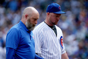 Jon Lester #34 of the Chicago Cubs walks off the field after being relieved in the second inning against the Cincinnati Reds at Wrigley Field on August 17, 2017 in Chicago, Illinois.