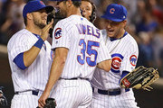 Cole Hamels #35 of the Chicago Cubs is congratulated by David Bote #13 (L) and Albert Almora Jr.#5 (R) after a complete game win against the Cincinnati Reds at Wrigley Field on August 23, 2018 in Chicago, Illinois. The Cubs defeated the Reds 7-1.
