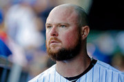 Jon Lester #34 of the Chicago Cubs looks on while walking in the dugout after pitching against the Cincinnati Reds during the seventh inning at Wrigley Field on September 15, 2018 in Chicago, Illinois.