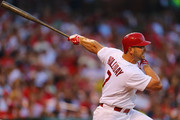 Matt Holliday #7 of the St. Louis Cardinals hits an RBI double against the Cincinnati Reds in the third inning at Busch Stadium on August 20, 2014 in St. Louis, Missouri.