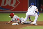 Jose Peraza #9 of the Cincinnati Reds steals second base in the seventh inning during MLB game action as the ball gtes away from Troy Tulowitzki #2 of the Toronto Blue Jays at Rogers Centre on May 30, 2017 in Toronto, Canada.