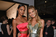 "Lais Ribeiro (L) and Romee Strijd attend the ""ANGELS"" by Russell James book launch and exhibit hosted by Cindy Crawford and Candice Swanepoel at Stephan Weiss Studio on September 6, 2018 in New York City."
