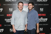 Filmmaker Marc Webb (L) and guest attend The Cinema Society with Men's Fitness and FIJI Water special screening of Marvel's 'Guardians of the Galaxy' at Crosby Street Hotel on July 29, 2014 in New York City.