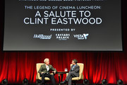 "Recipient of the Fandango Fan Choice award for Favorite Film of 2014, 'American Sniper,' Clint Eastwood (L) and Hollywood Reporter executive editor Stephen Galloway speak onstage during CinemaCon and Warner Bros. Pictures Present ""The Legend of Cinema Luncheon: A Salute to Clint Eastwood"" at Caesars Palace during CinemaCon, the official convention of the National Association of Theatre Owners, on April 22, 2015 in Las Vegas, Nevada."