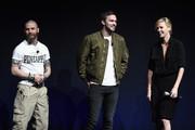 "(L-R) Actors Tom Hardy, Nicholas Hoult and Charlize Theron speak onstage Warner Bros. Pictures Invites You to ""The Big Picture"", an Exclusive Presentation Highlighting the Summer of 2015 and Beyond at The Colosseum at Caesars Palace during CinemaCon, the official convention of the National Association of Theatre Owners, on April 21, 2015 in Las Vegas, Nevada."