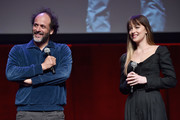 Director Luca Guadagnino (L) and actor Dakota Johnson speak onstage during CinemaCon 2018- Amazon Studios: An Exciting New Year of Great Product for Cinemas Program at Caesars Palace during CinemaCon, the official convention of the National Association of Theatre Owners, on April 26, 2018 in Las Vegas, Nevada.