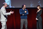 (L-R) Head of Marketing & Distribution at Amazon Studios, Bob Berney, director Luca Guadagnino and actor Dakota Johnson speak onstage during CinemaCon 2018- Amazon Studios: An Exciting New Year of Great Product for Cinemas Program at Caesars Palace during CinemaCon, the official convention of the National Association of Theatre Owners, on April 26, 2018 in Las Vegas, Nevada.