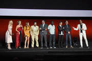 (L-R) Actors Leslie Bibb, Annabelle Wallis, Isla Fisher, Jake Johnson, Jon Hamm, Hannibal Buress, Jeremy Renner, Ed Helms and Will Arnett speak onstage during CinemaCon 2018 Warner Bros. Pictures Invites You to ?The Big Picture?, an Exclusive Presentation of our Upcoming Slate at The Colosseum at Caesars Palace during CinemaCon, the official convention of the National Association of Theatre Owners, on April 24, 2018 in Las Vegas, Nevada.