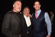 (L-R) Arnold Schwarzenegger, Paramount Pictures Chairman & CEO Jim Gianopulos, and John Cena attend CinemaCon 2019- Paramount Pictures Invites You to an Exclusive Presentation Highlighting Its Upcoming Slate at The Colosseum at Caesars Palace during CinemaCon, the official convention of the National Association of Theatre Owners, on April 4, 2019 in Las Vegas, Nevada.