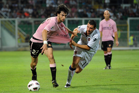 javier Pastore (L) of Palermo and Andrea Lazzari of Cagliari battle for the ball during the Serie A match between US Citta di Palermo and Cagliari Calcio at Stadio Renzo Barbera on August 29, 2010 in Palermo, Italy.