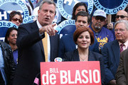 Democratic mayoral nominee Bill de Blasio (L) speaks as Christine Quinn (R), New York City Council Speaker and former mayoral hopeful, stands by at a news conference where Quinn endorsed de Blasio outside City Hall on September 17, 2013 in New York City. De Blasio will face Republican Joseph Lhota in the general mayoral election November 5, 2013, with the winner succeeding current Mayor Michael Bloomberg.