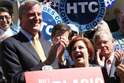 Democratic mayoral nominee Bill de Blasio (L) laughs with Christine Quinn (R), New York City Council Speaker and former mayoral hopeful, at a news conference where Quinn endorsed de Blasio outside City Hall on September 17, 2013 in New York City. De Blasio will face Republican Joseph Lhota in the general mayoral election November 5, 2013, with the winner succeeding current Mayor Michael Bloomberg.